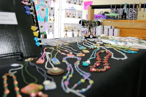 Display table with bead necklaces