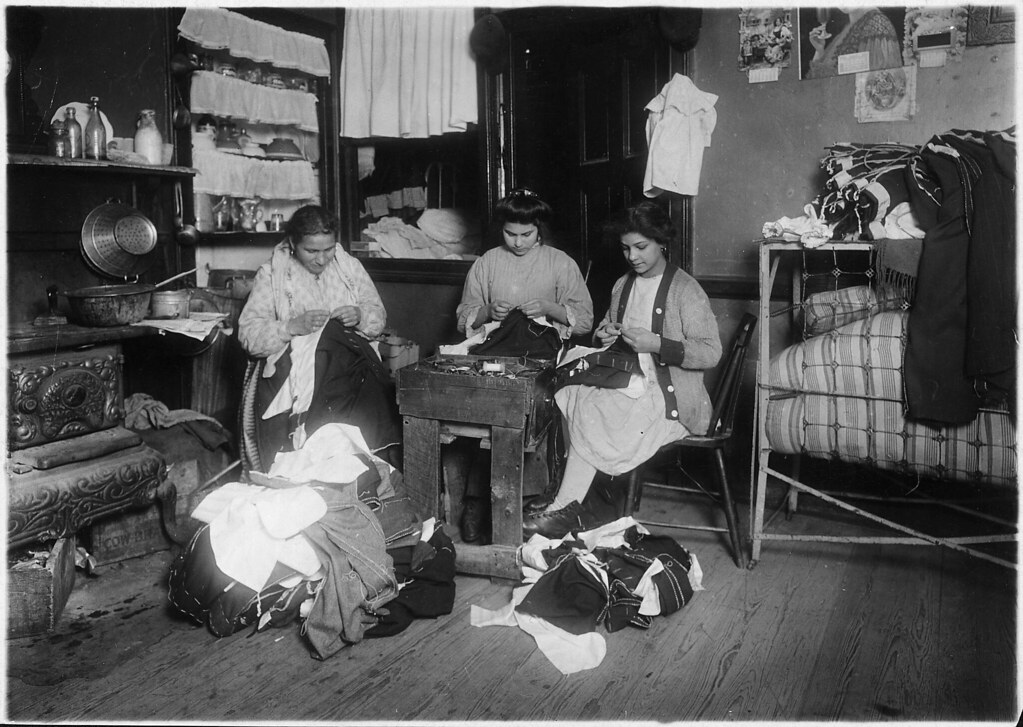 Family finishing pants. None of them spoke English. New York City, March 1912