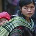 Black Hmong girl with baby
