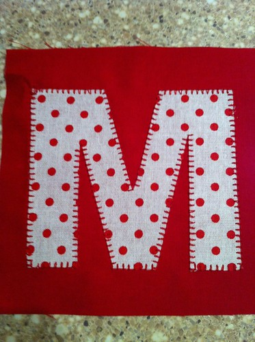 The embroidered M