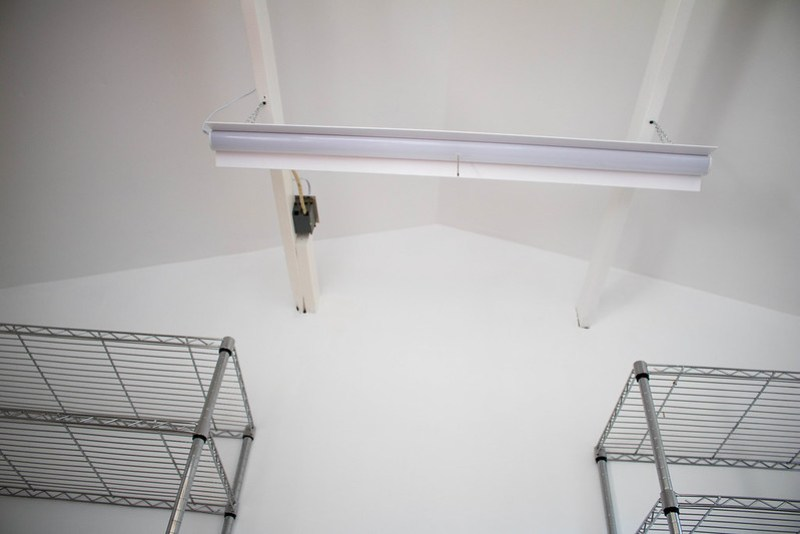 Painted ceiling and beams plus a new light in the storage area