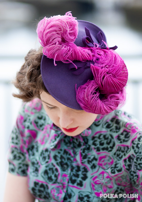From the top - a 1940s New York Creation tilt hat in vibrant purple, crowned with curling ostrich feathers in shocking raspberry pink.