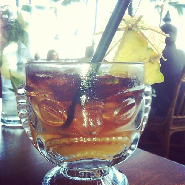 Mai Tai from Hula Grill in Wakiki. There's an umbrella in my pineapple in my Tiki Man drink.