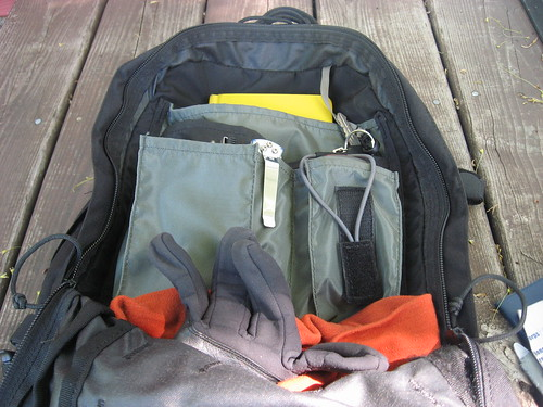 backpack features: segmented outer compartment for organization of snivel gear