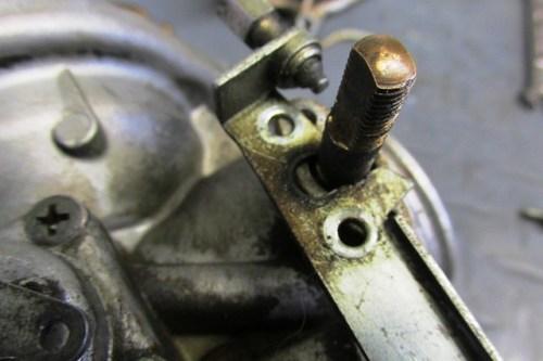 Removing Throttle Lever Bracket From Groove on Throttle Shaft