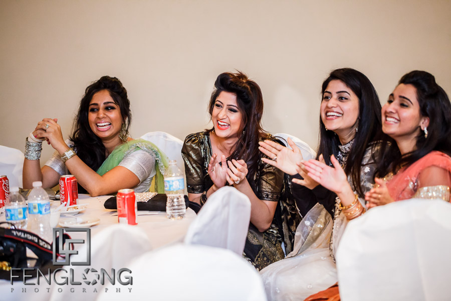 Guests clapping and laughing at Indian wedding reception