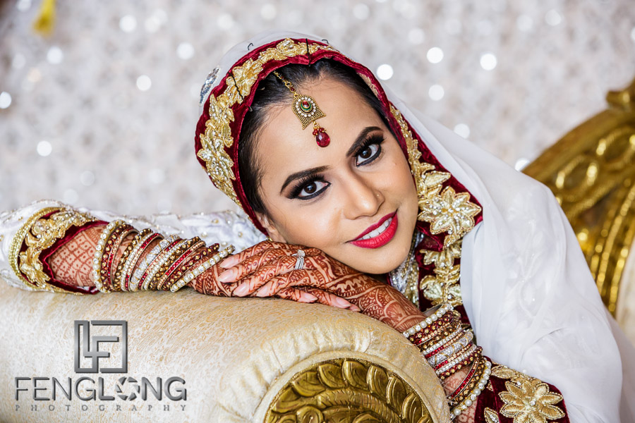 Bride posing for formal portrait photo at Indian wedding reception