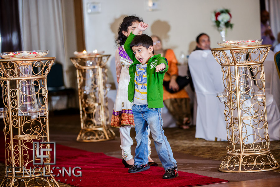 Little kid dancing during wedding reception