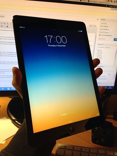 iPad held in one hand