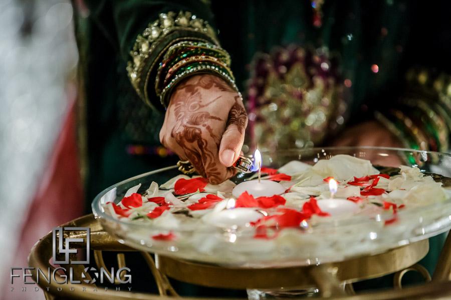 Lighting candles in flower petals