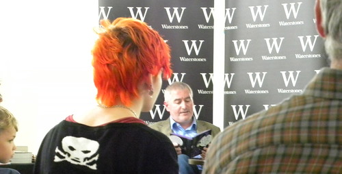 Chris Riddell reading to a cross-section of his fans