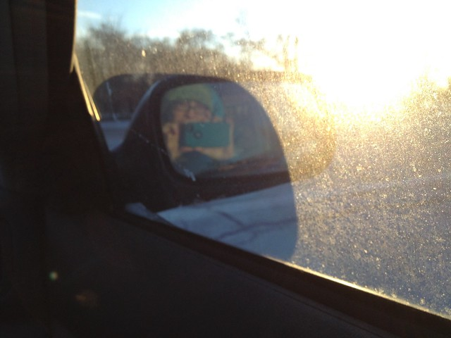 Self-portrait in a side-view mirror