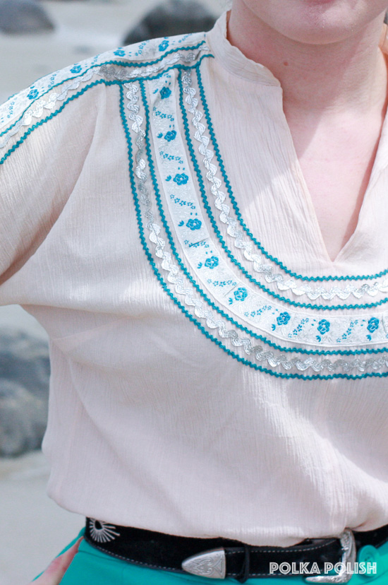 Detail of the elaborate silver and aqua trims on this pale pink 1950s patio blouse