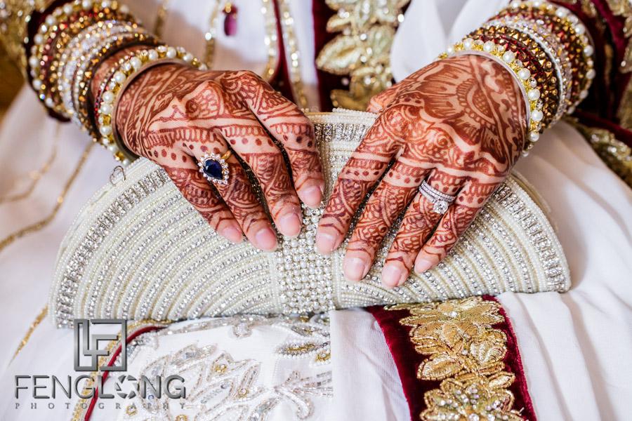 Close up of Indian bride's henna design on wedding reception