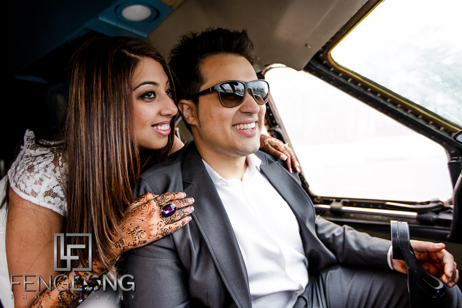 Indian groom flying airplane for pre-wedding photo session