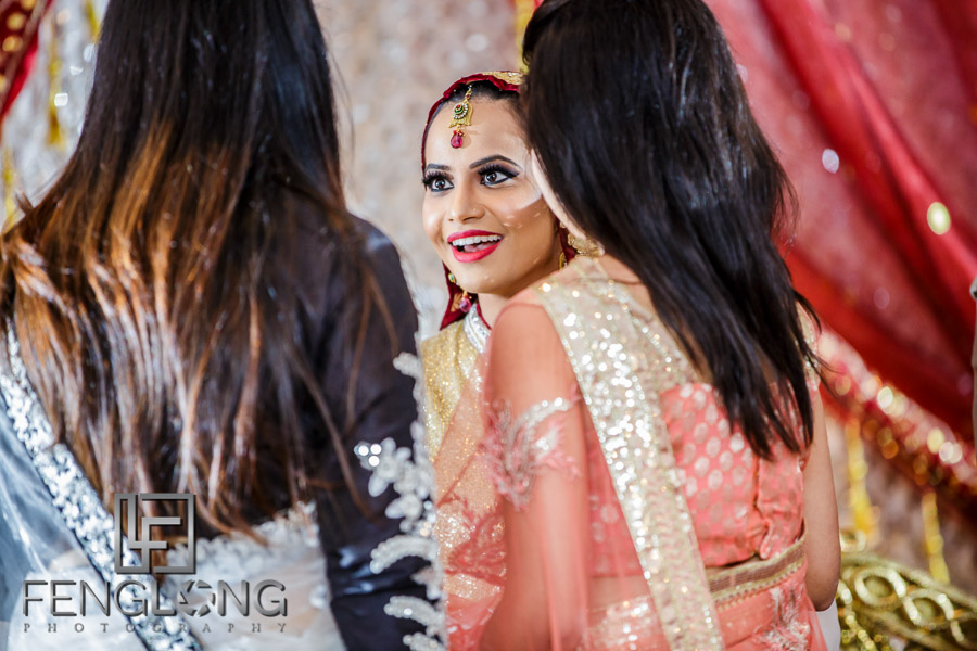Bride talking to guests during reception