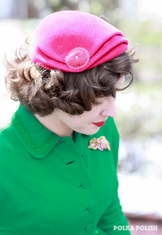 Rhinestones and pleating on the raspberry pink hat mimic designs in the rhinestone brooch set and green vintage skirt suit