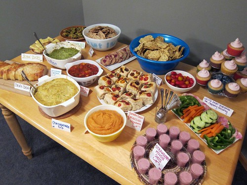Table full of colorful desserts and savory items.