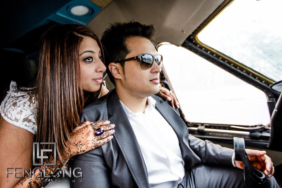 Indian Bride and groom in cockpit of cargo plane for unique pre-wedding shoot
