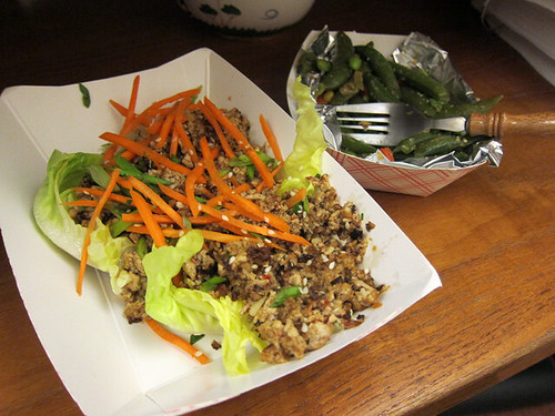 Butter lettuce leaf filled with ground tofu and topped with julienned carrots.