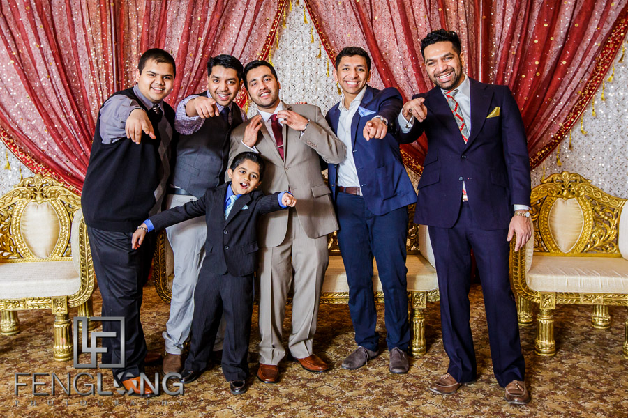 Groom and guests posing for humorous photo