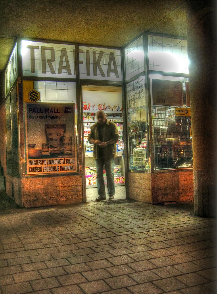 Man Leaving Tobacconist's (at Night)