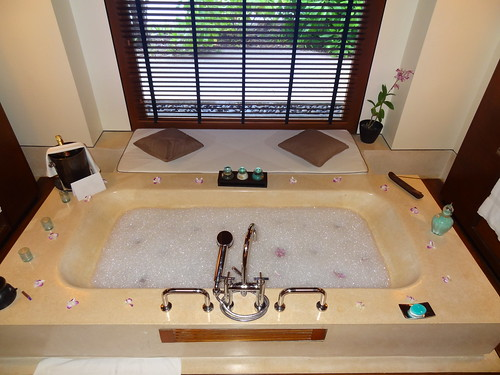 Bubble bath with orchid petals and champagne at Reethi Rah resort.