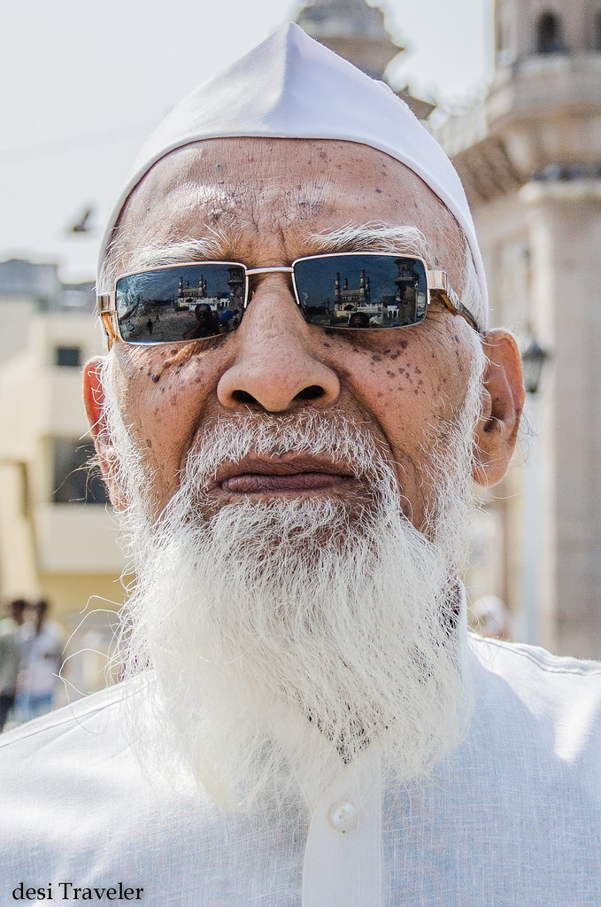 charminar in reflections of sunglasses of an old man