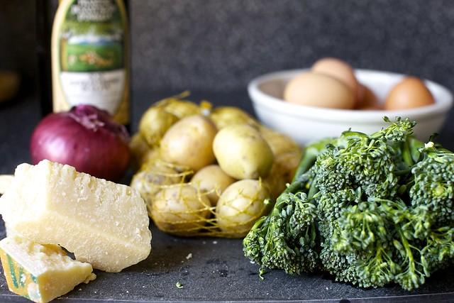 parmesan, onion, olive oil, potatoes, eggs, broccolini