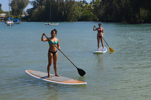 Photo of two girls paddle boarding in Reed's Bay, Hilo, Hawaii
