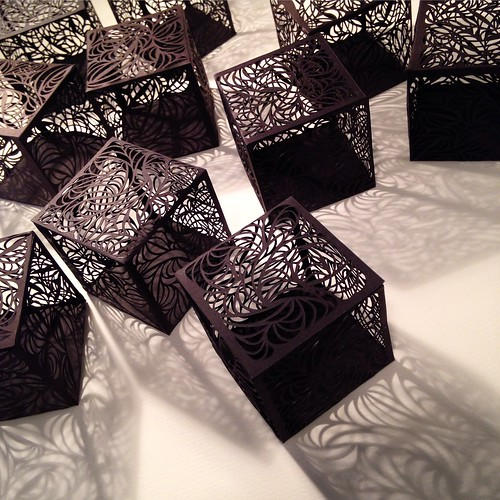 Ten cut paper cubes