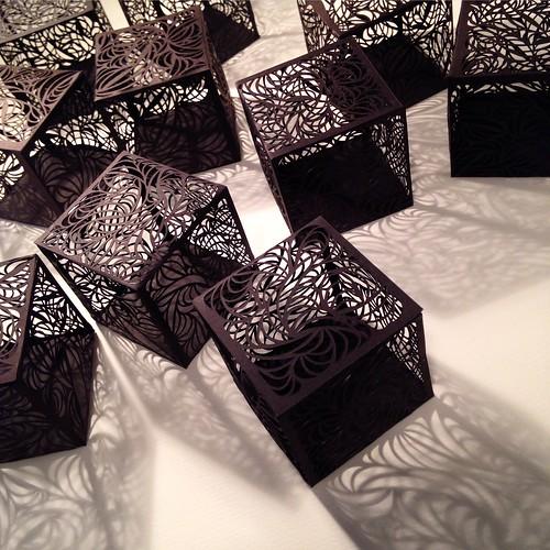 Ten cut paper cubes
