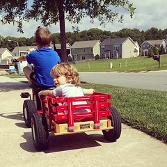 Charlie catching a ride with his neighbor buddy.