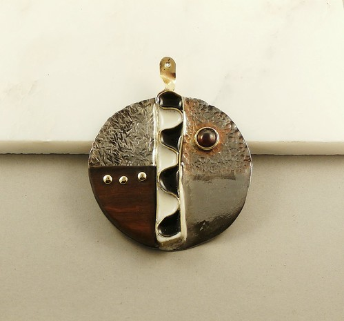 pendant welding steel, rose wood, Garnet7mm, brass, epoxy, pigment by Wolfgang Schweizer