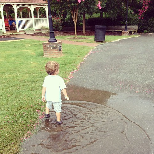 The upside of the rain- not much says happy like a two year old in a mud puddle.