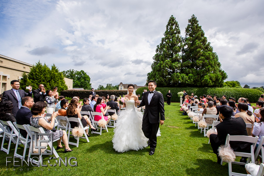 Chinese bride and groom walk down the aisle after wedding ceremony