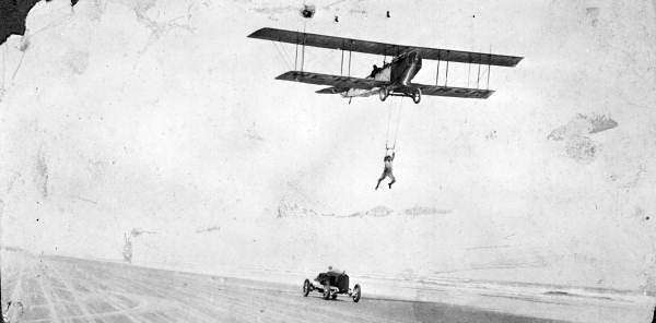 Daredevil attempts transfer between airplane and race car on the beach