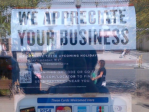 Lake George Post Office sign: We appreciate your business - Really now?