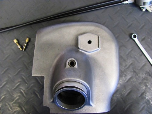Left Air Box Cover with Casting for Choke Body at Top