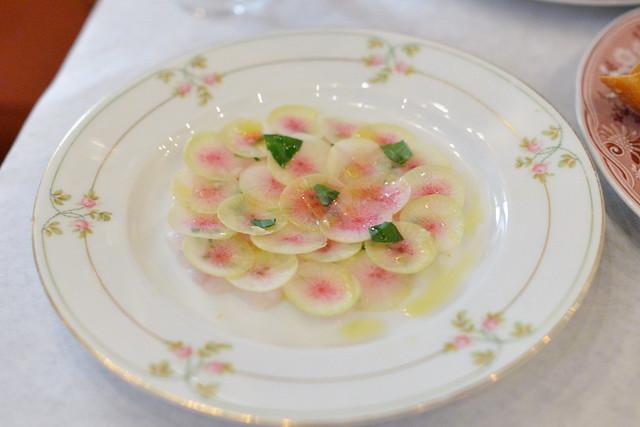 Crudo of Fluke watermelon radish, basil, olive oil, meyer lemon