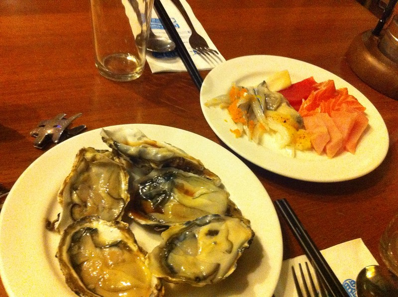 Starters of sashimi and raw oyster