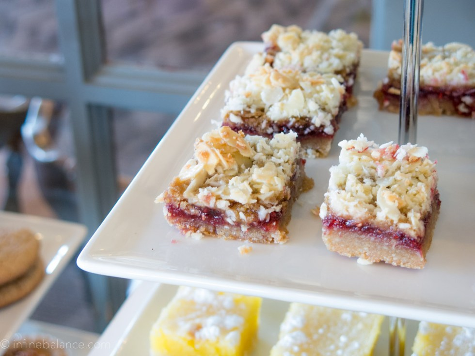 raspberry crumb bars on the sweet table at a baby shower