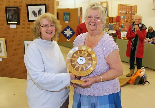 Nicky Baker (L) accepts her award from Ann Humphreys