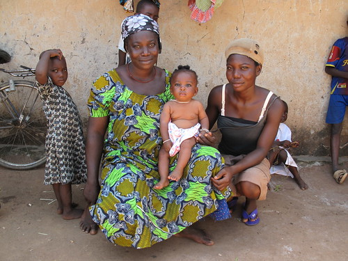 Bariasu Issahaku with her eldest daughter and youngest child in her compound at Passe, Upper West Region