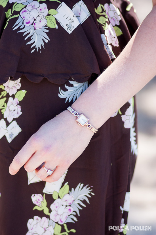 A vintage wristwatch and ring add the perfect subtle finishing touches to an otherwise very dramatic 1940s dress with scalloped peplum and mail-themed novelty print