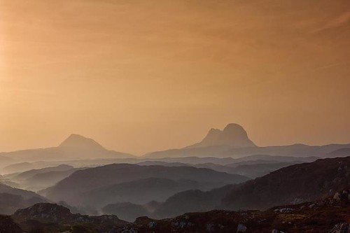 Share this if you love landscapes of Scotland ! A dull orange glow just after sunrise with the mist still filling the glens below the peaks of Canisp and Suilven in Sutherland, Northwest Highlands, Scotland. http://bit.ly/15nQ6h6 by emperor1959