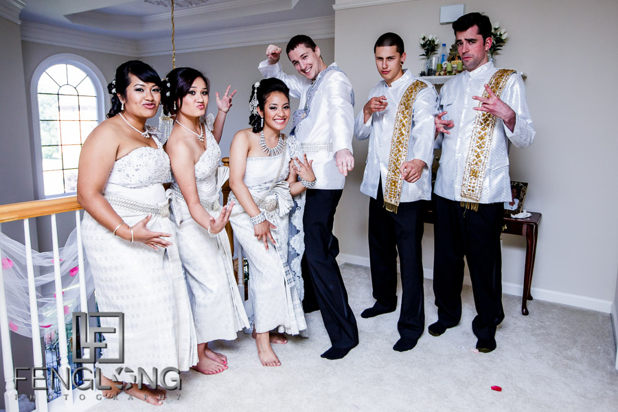 Cambodian bride and American groom take fun photos in traditional Cambodian wedding outfits
