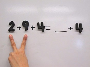 This image shows two fingers pointing to the numbers 2 and 9.