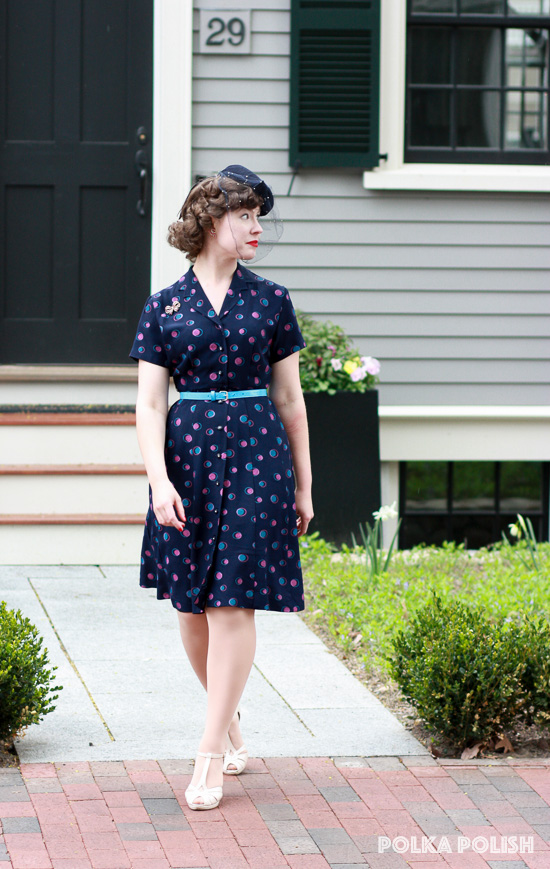 Navy blue 1940s day dress with teal and pink polka dots