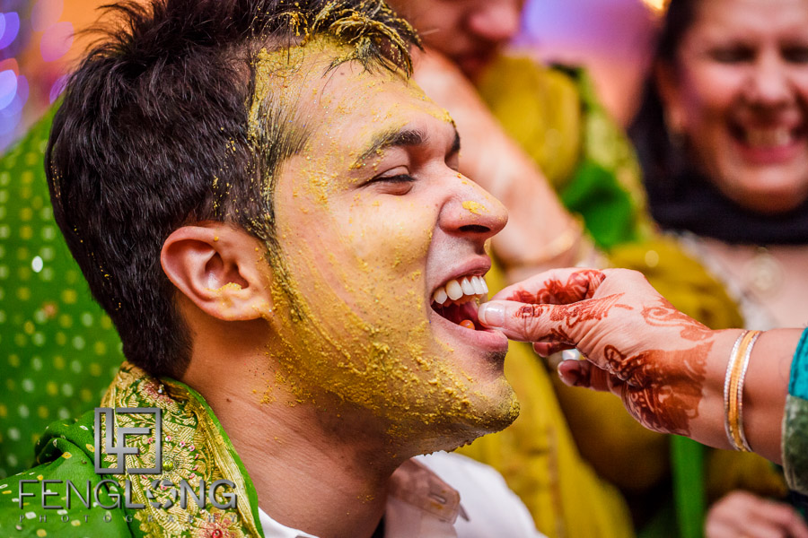 Ismaili Indian groom during pithi ceremony getting fed sweets